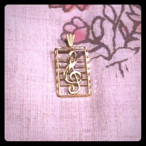 Jewelry - 14k gold delicate faceted music pendant